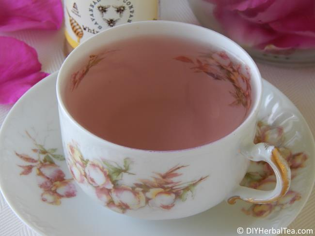 Pink tea in a flower-patterned cup